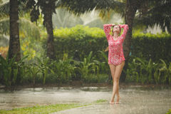 Portrait of beautiful woman under the tropical rain Royalty Free Stock Image