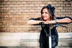 Portrait of beautiful woman using eco transportation. P Royalty Free Stock Photos