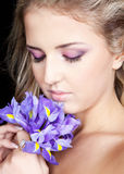 Portrait of beautiful woman with violet flowers Royalty Free Stock Photos