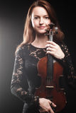 Portrait of beautiful woman with violin Royalty Free Stock Photography