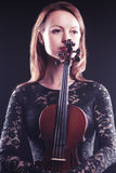 Portrait of beautiful woman with violin Stock Photo