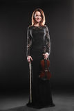 Portrait of beautiful woman with violin Stock Images