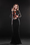 Portrait of beautiful woman with violin Royalty Free Stock Images