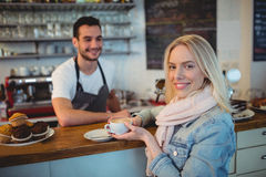 Portrait of beautiful woman with waiter at cafe Royalty Free Stock Photography