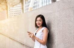 Portrait beautiful woman walking in the city,Happy and smiling,Outdoor lifestyle,Female with positive attitude expressing energy i. Portrait beautiful asian royalty free stock photography
