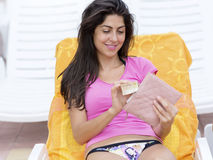 Portrait of beautiful woman with wallet and bill in the hands stock image