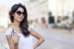 Portrait of a beautiful  woman with wallet in the hand Royalty Free Stock Photos