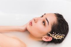 Portrait of a beautiful woman in the water. wellness treatment in bath royalty free stock images
