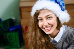 Portrait of the beautiful woman wearing a blue santa hat Stock Photo