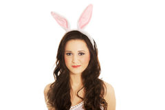 Portrait of beautiful woman wearing bunny ears Stock Photo