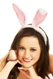 Portrait of beautiful woman wearing bunny ears Royalty Free Stock Image
