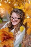 Portrait of beautiful woman wearing fashion glasses during the autumn Royalty Free Stock Images