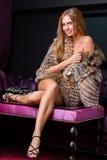 Beautiful woman wearing fur Stock Photos