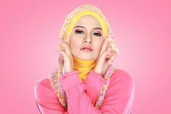 Portrait of beautiful woman wearing hijab. Fashion portrait of young beautiful asian muslim woman with pink costume wearing hijab Stock Images
