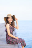 Portrait of beautiful woman wearing long dress and straw hat loo Stock Images