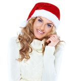 Portrait of a beautiful woman wearing a santa hat. Smiling Stock Photos