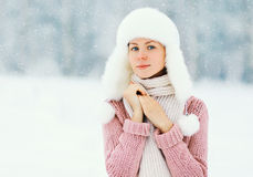 Portrait beautiful woman wearing a sweater and hat over winter Stock Image
