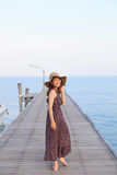 Portrait beautiful woman wearing wide straw hat and long dress w Royalty Free Stock Photography