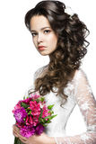 Portrait of a beautiful woman in  wedding dress in the image of the bride with flowers in her hair.  Royalty Free Stock Image