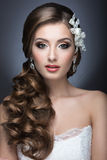 Portrait of a beautiful woman in a wedding dress in the image of the bride. Stock Photography