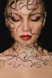 Portrait of beautiful woman with wet hair and face art Royalty Free Stock Photo