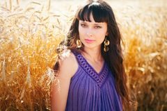 Portrait of a beautiful woman in a wheat field. On a warm summer photo Stock Photo