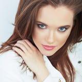 Portrait of Beautiful Woman. White background. Stock Image