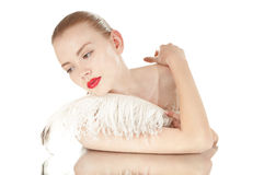 Portrait of a beautiful woman with white feather. royalty free stock photo