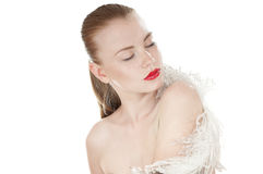 Portrait of a beautiful woman with white feather. stock image