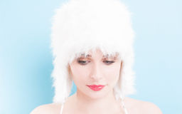 Portrait of a beautiful woman with white fur hat Stock Photo