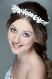 Portrait of beautiful woman with white garland Stock Photos