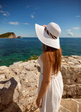 Portrait of beautiful woman in white hat looking at sea Royalty Free Stock Photo