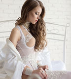 Portrait of a beautiful woman in the white lingerie Stock Photo