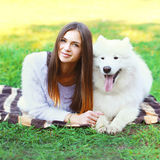 Portrait of beautiful woman with white Samoyed dog Stock Photo