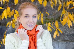 Portrait of beautiful woman in white sweater posing against ston Stock Images