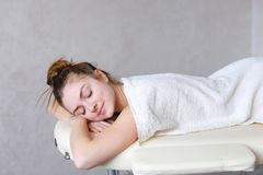 Portrait of beautiful woman who relaxes after massage and looks stock photography