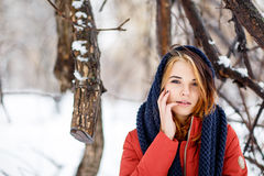 Portrait of a beautiful woman in a winter park. The park is a lo Stock Photos