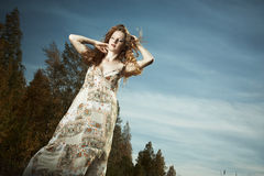 Portrait of the beautiful woman in wood Royalty Free Stock Photography