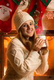 Portrait of beautiful woman in woolen sweater drinking tea at fi Royalty Free Stock Images
