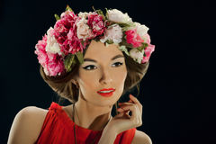 Portrait of a beautiful woman with a wreath royalty free stock photography