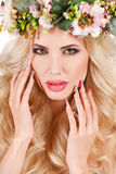Portrait of a beautiful woman in a wreath of flowers. Royalty Free Stock Images