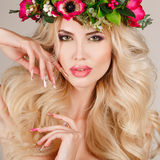 Portrait of a beautiful woman in a wreath of flowers. stock photography