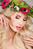Portrait of a beautiful woman in a wreath of flowers. Royalty Free Stock Photos