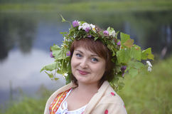 Portrait of a beautiful woman with a wreath of grass on her head royalty free stock images
