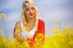 Portrait of beautiful woman in yellow flowers Royalty Free Stock Image