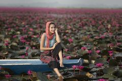 Portrait of a beautiful women on boat in lotus garden. Royalty Free Stock Photos