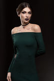 Portrait of beautiful women in fashion green dress Royalty Free Stock Photography