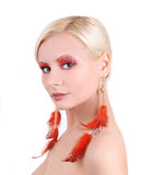 Portrait of beautiful women with feathers earrings Royalty Free Stock Photography