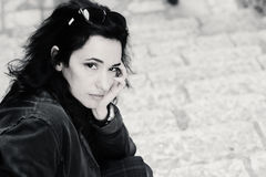 Portrait of beautiful 35 years old woman. Portrait of sad 35 years old woman sitting in the street Royalty Free Stock Images