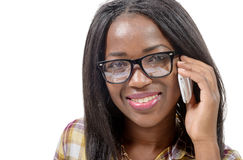 Portrait of a beautiful young african woman talking on cell phone Royalty Free Stock Image